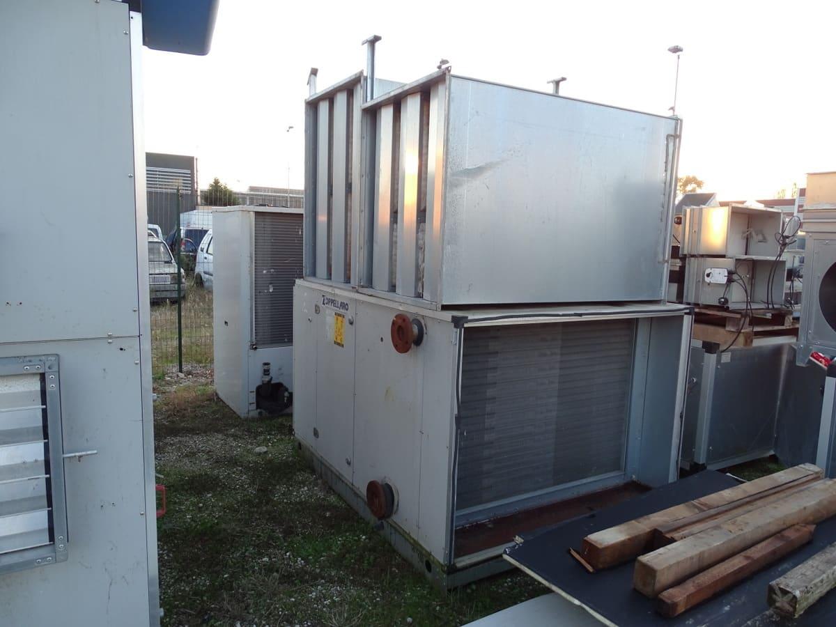Impianto refrigeratore e riscaldamento per grandi strutture